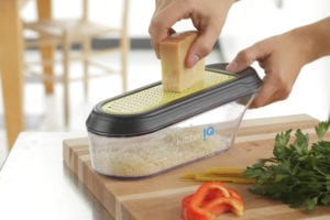 Cheese grater with container
